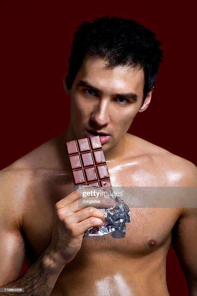 Naked man covered in chocolate